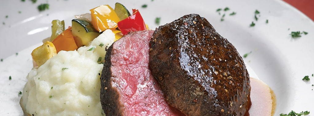 """MICHAELS """"SIGNATURE"""" PEPPER-CRUSTED  BEEF TENDERLOIN With Our """"Classic"""" Ancho Chile-Bourbon Sauce."""